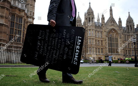 Stock Photo of Ladbrooks' Robin Huchision Carries a Ladbrooks Betting Board Giving the Odds On Who Will Be the Next British Prime Minister Outside the Houses of Parliament in London Britain 05 June 2009 Transport Secretary Geoff Hoon Has Become the Third Cabinet Minister to Walk out of Government in the Past Day His Departure Follows John Hutton Who Quit As Defence Secretary and James Purnell Who Resigned As Work and Pensions Secretary On Thursday