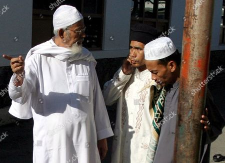 Muslim Cleric Abu Bakar Ba'asyir Chats with His Staffs As He Walks to a Mosque Shortly Before a Prayer at His Boarding School in Solo Central Java Indonesia On Thursday 15 June 2006 Authorities Released Cleric Abu Bakar Bashir From Prison On Wednesday After He Served 26 Months in Prison For Giving His Blessing to the 2002 Bali Nightclub Bombings Freed Firebrand Indonesian Muslim Cleric Abu Bakar Baasyir Called the Militants Who Carried out Terrorist Attacks As 'Misguided' Holy Warriors Saying He Did not Agree Wih Their Methods Local Media Reports Said Thursday
