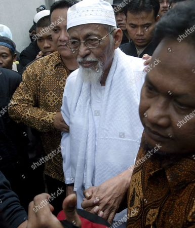 Islamic Militant Cleric Abu Bakar Ba'asyir Escorted by His Supporters During His Visit at Crescent Star Party (pbb) in Jakarta Indonesia On Monday 03 July 2005 Ba'asyir Met with Several Pbb's Leaders and Delivered a Speech For Pbb's Supporters Indonesia Will Take in Effect Various Restrictive Measures On Abubakar Baasyir Including a Travel Ban Due to the Militant Clerics Inclusion On the Uns Consolidated List of Terrorists