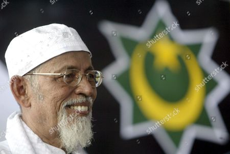 Stock Picture of Indonesian Muslim Militant Cleric Abu Bakar Ba'asyir Smiles During His Visit at the Crescent Star Party (pbb) in Jakarta Indonesia On Monday 03 July 2005 Ba'asyir Met with Several Pbb Leaders and Gave a Speech to Pbb's Supporters Indonesia Will Effect Various Restrictive Measures On Abubakar Baasyir Including a Travel Ban Due to the Militant Clerics Inclusion On the Un's Consolidated List of Terrorists
