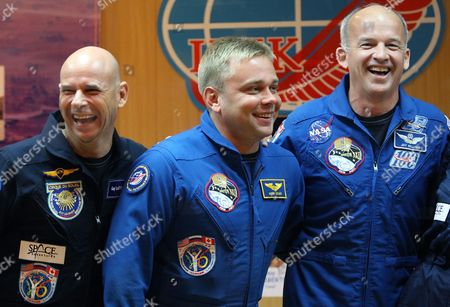 Us Astronaut Jeffrey Williams (r) Canadian Billionaire Guy Laliberte (l) and Russian Cosmonaut Maxim Surayev (c) Smile During Press Conference at the Baikonur Cosmodrome in Kazakhstan 29 September 2009 the Space Rocket with International Space Crew Blast Off to the International Space Station (iss) On 30 September 2009