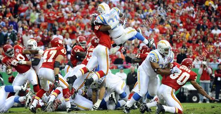 San Diego Chargers Player Ladainian Tomlinson (r) is Stopped by Kansas City Chiefs Player Corey Mays (l) While Trying to Go Over the Top of the Line For a Touchdown in the First Half of the Game at Arrowhead Stadium in Kansas City Missouri Usa 25 October 2009