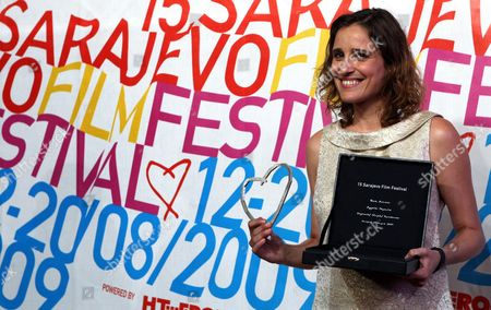 Greek Actress Aggeliki Papoulia Holds Her Best Actress Award For the Film 'Dogtooth' Directed by Yorgos Lanthimos at Bosnian National Theatre Venue During the Closing Ceremony of 15th Sarajevo Film Festival in Sarajevo Bosnia and Herzegovina Aug 20 2009