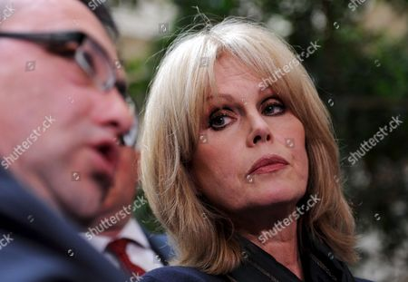 British Actress Joanna Lumley (r) with British Immmigration Minister Phil Woolas Following a Meeting in London Britain 07 May 2009 Phil Woolas Sought to 'Reassure' Joanna Lumley That Rulings Rejecting Former Gurkha Soldiers' Rights to Settle in the Britian Will Be Reconsidered During Their Meeting 07 May the Immigration Minister Held a Hasty Meeting with the Actress and Gurkha Campaigner in the Bbc's Westminster Office to Discuss the Verdicts