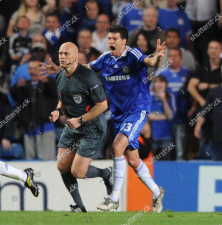 Michael Ballack of Chelsea Chases Referee Tom Henning Ovrebo After an Appeal For a Penalty i Turned Down During the Second Leg of the Uefa Champions League Semi Final Match at Stamford Bridge Stadium London Britain 06 May 2009