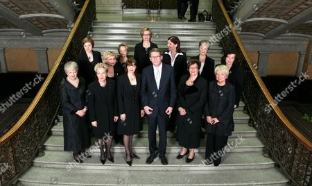 Finnish Prime Minister Matti Vanhanen (C) poses with the female ministers of his new government including (not in order) Minister of Transport Anu Vehviläinen, Minister of the Environment Paula Lehtomäki, Minister of Social Affairs and Health Liisa Hyssälä, Minister of Communications Suvi Linden, Minister of Public Administration and Local Government Mari Kiviniemi, Minister of Agriculture and Forestry Sirkka-Liisa Anttila, minister of Education Sari Sarkomaa, Minister of Labour Tarja Cronberg, Minister of Justice Tuija Brax, Minister of Immigration and European Affairs Astrid Thors, Minister of the Interior Anne Holmlund and Minister of Health and Social Services Paula Risikko.