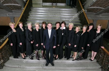 Finnish Prime Minister Matti Vanhanen (C) poses with the female ministers of his new government: L-R Minister of Transport Anu Vehviläinen, Minister of the Environment Paula Lehtomäki, Minister of Social Affairs and Health Liisa Hyssälä, Minister of Communications Suvi Linden, Minister of Public Administration and Local Government Mari Kiviniemi, Minister of Agriculture and Forestry Sirkka-Liisa Anttila, minister of Education Sari Sarkomaa, Minister of Labour Tarja Cronberg, Minister of Justice Tuija Brax, Minister of Immigration and European Affairs Astrid Thors, Minister of the Interior Anne Holmlund and Minister of Health and Social Services Paula Risikko.