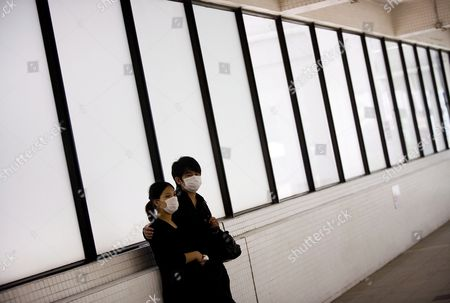 Stock Photo of People Wear Protective Masks at the Princess Margaret Hospital in Hong Kong China 15 May 2009 Who Director- General Margaret Chan Fung Fu-chun Warned Against a False Sense of Security and of Great Uncertainty About the H1n1 Flu Virus in Southeast Asia