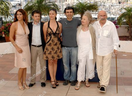 (l-r) Turkish Actors Nursel Kose Baki Davrak and Nurgul Yesilcay Turkis Director Fatih Akin German Actress Hanna Schygulla and Turkish Actor Tuncel Kurtiz Pose During a Photocall For Turkish Director Fatih Akin's Film 'The Edge of Heaven' ('auf Der Anderen Seite') Running in Competition at the 60th Cannes Film Festival 23 May 2007 in Cannes France