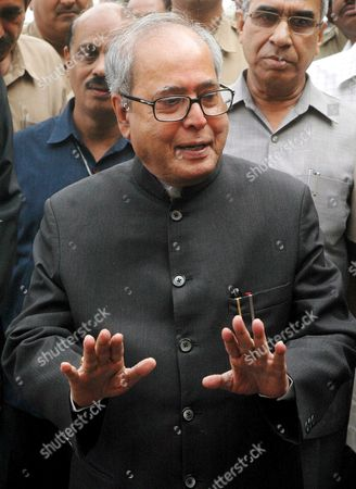 Newly Appointed India's Foreign Minister Pranab Mukherjee Gestures at His Arrival at the Ministry of External Affairs in New Delhi India On Wednesday 25 October 2006 the Indian Government On Tuesday Appointed Pranab Mukherjee As India's New Foreign Minister Nearly a Year After the Previous Minister Natwar Singh Was Forced to Resign Over Charges of Benefiting From the Iraqi Oil-for-food Scandal Mukherjee Had Been the Defence Minister Ever Since the Congress- Led United Progressive Alliance (upa) Came to Power in 2004