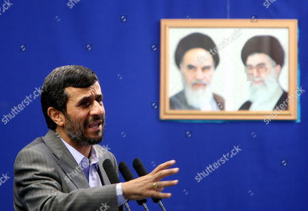 Iranian President Mahmoud Ahmadinejad Speaks at a Friday Prayer Ceremony Tehran Iran 28 August 2009 Behind Ahmedinejad Are Portraits of Iran's Supreme Leader Ayatollah Ali Khamenei (r) and the Late Supreme Leader of the 1979 Islamic Revolution Grand Ayatollah Ruhollah Khomeini (l) Ahmadinejad Called For Prosecuting the Countrys Opposition Leaders For Leading the Protests Against Alleged Fraud in the 12 June Presidential Elections Ahmadinejad Was Referring to Defeated Presidential Candidates Former Premier Mir-hossein Moussavi and Former Parliamentary Speaker Mehdi Karroubi As Well As Former Presidents Akbar Hashemi-rafsanjani and Mohammad Khatami Who Are the Main Leaders of the Opposition Opposition Supporters Who Have not Yet Acknowledged Ahmadinejads Re-election Have Staged Street Demonstrations Against Ahmadinejad Protesting the Alleged Vote Rigging in Favour of the Incumbent the Crowd at the Prayer Ceremony Approved Ahmadinejads Demand Shouting 'The Leaders of the Unrests Should Be Executed'