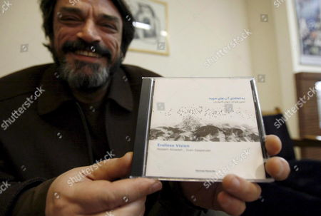 Iranian Veteran Musician Hossein Alizadeh Proudly Shows His Cd 'Endless Vision' On Monday 15 January 2007 in the Tehran Bureau of Hermes Records Despite All Problems and Restrictions For Musicians in Islamic Iran Alizadeh Latest Piece 'Endless Vision' Earned Him and Hermes Records a Grammy Nomination in the Category World Music