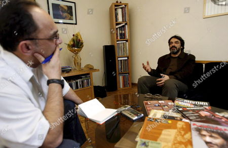 Iranian Veteran Musician Hossein Alizadeh (r) Talks to a Journalist On Monday 15 January 2007 in the Tehran Bureau of Hermes Records Despite All Problems and Restrictions For Musicians in Islamic Iran Alizadeh Latest Piece 'Endless Vision' Earned Him and Hermes Records a Grammy Nomination in the Category World Music
