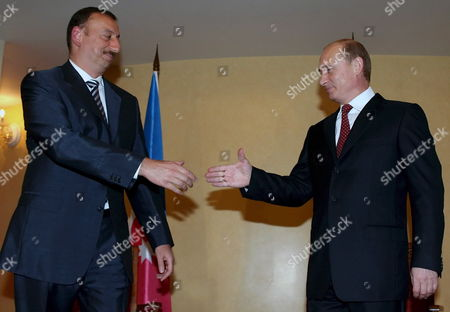Russian President Vladimir Putin (r) Shakes Hands with President of Azerbaijan Ilkham Aliev (l) As the Meet During the Second Summit of the Conference On Interaction and Confidence Building Measures in Asia (cica) in Almaty Friday 16 June 2006