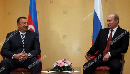 Russian President Vladimir Putin (r) Speaks with President of Azerbaijan Ilkham Aliev (l) As the Meet During the Second Summit of the Conference On Interaction and Confidence Building Measures in Asia (cica) in Almaty Friday 16 June 2006