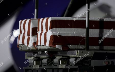 The Flag Draped Transfer Cases Containing the Remains of Us Army Sergeant Paul Brooks of Joplin Missouri (r) and Us Army Sgt 1st Class Brian Naseman of Bremen Ohio Sit Together During a Dignified Transfer Ceremony at the Dover Air Force Base Dover Delaware Usa On 24 May 2009