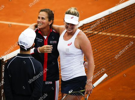 Coco Vandeweghe of the Usa (r) Celebrates with Teammate Mary Joe Fernandez (c) After Winning Against Samantha Stosur of Australia During Their Match of the 2016 Fed Cup Tennis Tournament World Group Playoff Between Australia and the United States at the Pat Rafter Arena in Brisbane Australia 17 April 2016