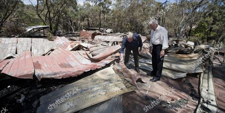 The Premier of Western Australia Colin Barnett (l) and Rob Johnson (r) Minister For Police in Western Australia Visits the Bush Fire Damaged Area in Roleystone Near Perth Australia 07 February 2011 the West Australian Fire and Emergency Authority (fesa) Believe 59 Homes Have Been Destroyed by a Bushfire Which Has Ravaged the Perth Hills District the Perth Fires Are the Latest in a String of Natural Disasters to Befall Australia and Follow On From 10 Years of Drought