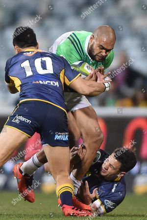 Christian Leali'ifano (l) and Matt Toomua (r) of the Brumbies Tackle Patrick Osborne (c) of the Highlanders During the Quarter Final Super Rugby Match Between the Act Brumbies and the Highlanders at Gio Stadium in Canberra Friday July 22 2016
