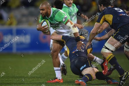 Patrick Osborne (2-l) of the Highlanders Tries to Push Through a Tackle by David Pocock (r) of the Brumbies During the Quarter Final Super Rugby Match Between the Act Brumbies and the Highlanders at Gio Stadium in Canberra Australia 22 July 2016