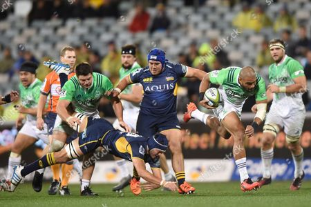 Patrick Osborne (2- R) of the Highlanders Steps Through a Tackle by Michael Wells of the Brumbies During the Quarter Final Super Rugby Match Between the Act Brumbies and the Highlanders at Gio Stadium in Canberra Friday July 22 2016