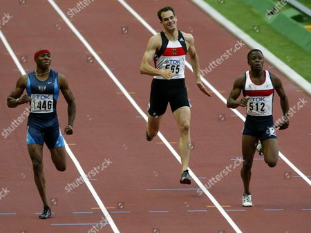 German Ingo Schultz (c) Runs Between Us Tyree Washington (l) and Britain's Daniel Caines During Heats in the Men's 400m Competition at the 9th Iaaf Athlectic World Championships at the Stade De France in Paris Saturday 23 August 2003 Epa Photo/epa/louisa Gouliamaki France Paris