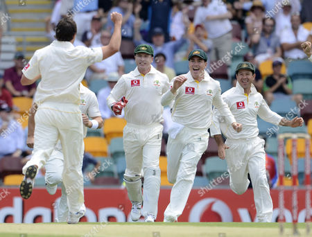 Australian Team Members (l to R) Ben Hilfenhaus Brad Haddin Marcus North and Ricky Ponting Celebrate the Wicket of England's Andrew Strauss On the First Day of the First Ashes Test at the Gabba Cricket Ground Brisbane Australia On 25 November 2010