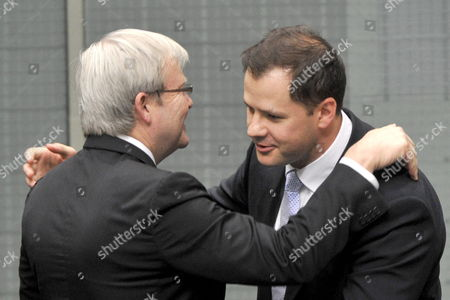 Australia's First Muslim Federal Mp Ed Husic (r) is Congratulated by Australian Foreign Minister Kevin Rudd After Delivering His Maiden Speech to the House of Representatives in Canberra Australia 28 October 2010 Husic Has Spoken of the Need to not Just Tolerate But to Remain Open to Those of Different Backgrounds Or Religions