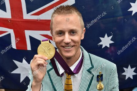 Australian Race Walker Jared Tallent Poses with His Belatedly Presented Gold Medal For the 50km Walk at the 2012 London Olympics in Melbourne Victoria Australia 17 June 2016 the 50km Walker Had Finally His 2012 Olympic Silver Medal Replaced by Gold at a Ceremony at the Treasury Building in Melbourne at Midday After Russian Athlete Sergey Kirdyapkin Was Revealed As a Drug Cheat Earlier This Year and Stripped of His Title