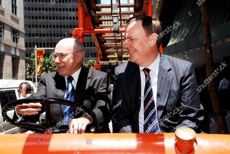 Australian Prime Minister John Howard (l) and Treasurer Peter Costello Sit in a Historic Fire Engine On Their Way to a Joint Speech in Sydney Australia On 21 November 2007 Howard Earlier Today Met with People in Central Sydney Walking Through Pitt Street and Martin Place to His Sydney Office