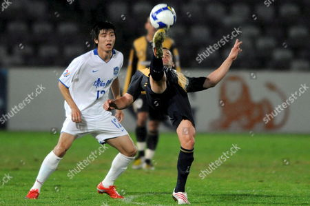 Central Coast Mariners Pedj Bojic (right) Takes Control of the Ball Despite Pressure From Tian Yuan of the Chinese Team Tianjin Teda During Their Afc Champions League Match in Gosford Australia 19 May 2009 Tianjin Won the Match 1-0