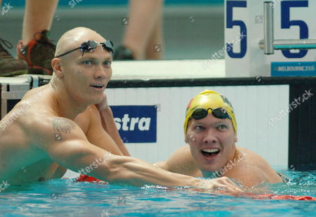 Ryan Pini (r) of Papua New Guinea Celebrates After Winning the Men's 50 Metres Butterfly with Australia's Michael Klim Who Took the Silver at the Swimming at the Commonwealth Games in Melbourne Monday 20 March 2006