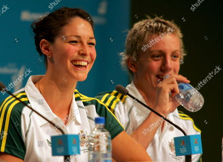 Acting Australian Captain Giaan Rooney (l) Laughs While Matthew Cowdrey Takes a Drink During the Commonwealth Games Australian Swimming Team Press Conference at the Melbourne Exhibition Centre Sunday 12 March 2006 Australian Swimming Team Head Coach Alan Thompson Expects His 53-person Team to Be the Dominant Force of the Pool When the Commonwealth Games Start Later This Week