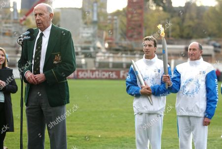 Former Australian Olympian John Landy (foreground) Speaks As Present and Past Olympians Matt Welsh (l) and Herb Elliot Holding the Olympic Torch Look On in Melbourne Australia On Saturday 5 June 2004 Landy Was Embroiled in a Controversy Earlier in the Week After He Declined to Carry the Torch After Refusing to Sign a Commercial Rights Waiver the Olympic Flame is Travelling Through Australia As Part of Its World Wide Journey to the Athens Olympics Australia Melbourne