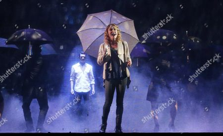 Rob Mills As 'Sam Wheat' (c Back) and Jemma Rix As 'Molly Jensen' (c Front) Performing During a Media Call For 'Ghost the Musical' at the Regent Theatre in Melbourne Australia 05 February 2016 the Musical Runs at the Regent Theatre From 05 February Until 13 March