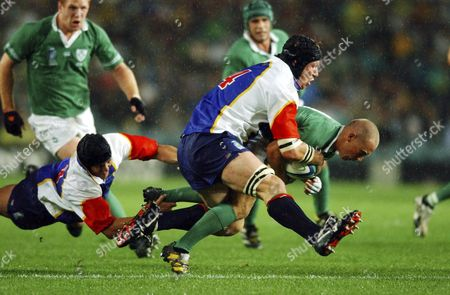 Stock Image of Irelands's Peter Stringer is Tackled by Namibia's Heino Senekal and Sean Furter (far Left) and During the Rugby World Cup Match Between Ireland and Namibia at Aussie Stadium in Sydney 19 October 2003