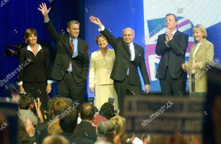 (l-r) Julia Anderson John Anderson Janette Howard Prime Minister John Howard Peter Costello and Tanya Costello Wave to Supporters After the Liberal and National Party Coalition Launched Their Election Campaign in Brisbane Sunday 26 September 2004