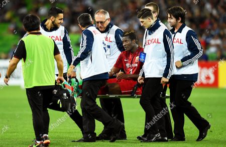 Shanghai's Asamoah Gyan (c) is Stretchered Off the Pitch After Being Injured During the Afc Champions League Group G Soccer Match Between Melbourne Victory and Shanghai Sipg at Aami Park in Melbourne Australia 24 February 2016