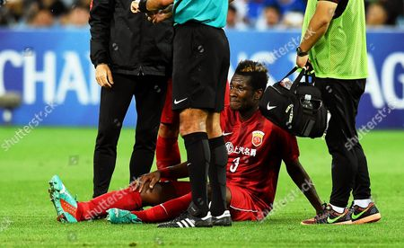 Shanghai's Asamoah Gyan Sits On the Pitch After Being Injured During the Afc Champions League Group G Soccer Match Between Melbourne Victory and Shanghai Sipg at Aami Park in Melbourne Australia 24 February 2016