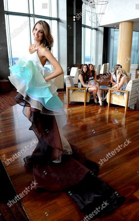Miss Universe Australia 2008 Laura Dundovic (l) Presents a Dress For the Australian National Costume Section of the Miss Universe Pagent Designed by Jayson Brunsdon in Sydney Australia 17 June 2008 Dundovic Will Wear the Dress at the Miss Universe Pageant On July 14 in Vietnam