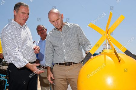 Stock Image of (l-r) Scott Hansen Director-general of the New South Wales (nsw) Department of Primary Industries; Phil Vanny Ceo of Surf Life Saving Nsw; and Nsw Minister For Primary Industries Niall Blair Inspect a Buoy at Coogee Beach in Sydney Australia 25 October 2015 Nsw's Government Has Announced a 16 Million Australian Dollar Shark Strategy Following a Spate of Shark Attacks On the Nsw North Coast the Program Will Include Aerial Surveillance Listening Stations to Track Tagged Sharks and Nets