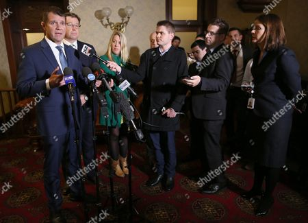 New South Wales (nsw) Premier Mike Baird (l) and Deputy Premier Troy Grant (2-l) Attend a Press Conference Concerning the Overnight Vote to Ban Greyhound Racing in Nsw at the State Parliament in Sydney New South Wales 24 August 2016