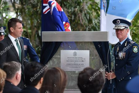 New South Wales (nsw) Premier Mike Baird (l) and Police Commissioner Andrew Scipione Unveil a Plaque at a Dedication Ceremony at Nsw Police Headquarters in Sydney Australia 30 September 2016 the Nsw Police Headquarters at Parramatta Has Been Renamed the Curtis Cheng Centre in Honor of the Nsw Police Employee Who Was Shot and Killed Outside the Building On 02 October Last Year