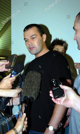 Nick Falconio (black Shirt) Arrives at Darwin Airport with His Brother Paul - (far Right ) Friday 14 May 2004 Ahead of the Committal Hearing of Bradley John Murdoch Which Starts On Monday Murdoch Stands Accused of Killing Mr Falconio's Brother Peter and Kidnapping His Girlfriend Joanna Lees