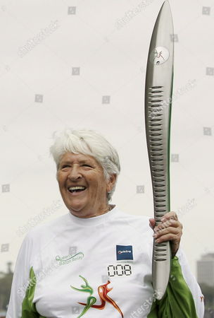 Olympic and Commonwealth Games Gold Medallist Dawn Fraser Holds the Queens Baton at the North Sydney Pool in Sydney During Australia Day Thursday 26 January 2006 the Baton is Passing Through Sydney For the Second Day During Its Last Leg of the 10 Month Journey Ending with the Opening Ceremony at the Melbourne Commonwealth Games On March 15