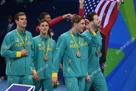 Australian Swimming Team Members James Roberts Cameron Mcevoy Kyle Palmer James Magnussen Wear Their Bronze Medals After the Men's 4x100m Freestyle Relay Final Race of the Rio 2016 Olympic Games Swimming Events at Olympic Aquatics Stadium at the Olympic Park in Rio De Janeiro Brazil 07 August 2016