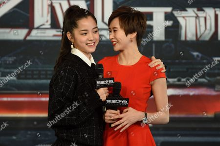 Actresses Nana Ouyang (l) and Erica Xia-hou Hug During a Press Conference to Announce the Start of the Production of Bleeding Steel in Sydney Australia 28 July 2016 Bleeding Steel is the Highest Budget Chinese Production to Be Filmed in Australia in the Last 20 Years