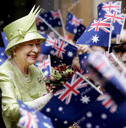 Britain's Queen Elizabeth Ll Receives Flowers From School Children Waving Australian Flags After the Commonwealth Day Service in Sydney Monday 13 March 2006 the Queen Will Open the Melbourne Commonwealth Games On March 15 2006