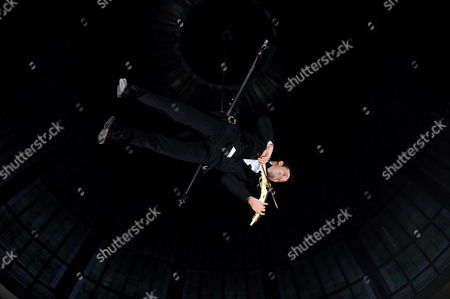 Australian Violinist Shenzo Gregorio Performs While Being Suspended From the Dome of the Queen Victoria Building in Sydney Australia On 16 June 2011 the Performance is the First of a Series of Free Cultural Events Happening Under the Queen Victoria Building Dome