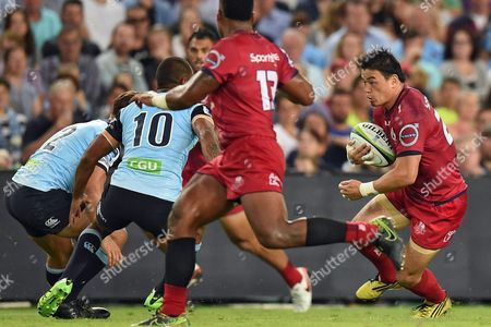Ayumu Goromaru of the Reds Runs the Ball Into the Waratahs Defence During the Super Rugby Match Between Australian Teams Nsw Waratahs and Queensland Reds at Allianz Stadium in Sydney Australia 27 February 2016